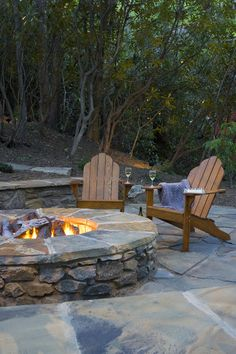 flagstone patio with fire pit and adirondack chairs