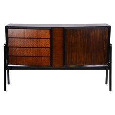 Teak and Ebonized Sideboard   From a unique collection of antique and modern sideboards at http://www.1stdibs.com/furniture/storage-case-pieces/sideboards/