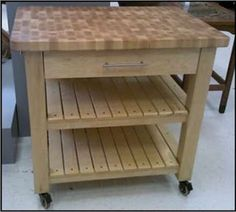 """Butcher Block Kitchen Prep Station The footprint of this project is 33 ¾"""" wide, 25 deep and 35 ½"""" tall. The island has one deep drawer and two . Diy Kitchen Island, Prep Kitchen, Kitchen Benches, Kitchen Ideas, Butcher Block Kitchen, Butcher Block Island, Kitchen Furniture, Wood Furniture, Furniture Refinishing"""