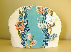 Tea cozy...looks like it is made from a 1950's tablecloth!
