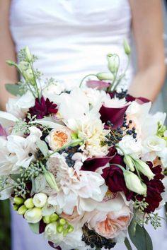 Garden roses, dahlias, burgundy calla lilies, lisianthus, blue viburnum berries, seeded eucalyptus