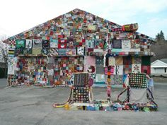 Full-on urban knitting extravaganza: an abandoned gas station decorated by artist Jennifer Marsh with the help of more than 2500 students in 29 states.