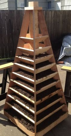 How to build a herb/strawberry tower. Vertical Garden Pyramid Tower #towergardenhowtobuilda #verticaltowergarden #strawberrytowergarden