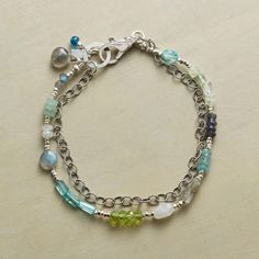 "VOYAGERS BRACELET -- In our handmade multi-gem bracelet, roped links hitch a ride with a caravan of gemstones. Handcrafted in USA with sterling silver, apatite, peridot, labradorite, iolite, amazonite and moonstone. Spring ring clasp. Exclusive. 7-1/2""L."