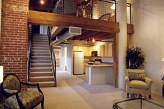 Nice loft... has the brick and type of space I would like for my bedroom.