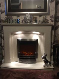 The Lynford fireplace sent in by Tina Brady featuring downlights and electric Downlights, Marble, Electric, Fire, Living Room, Photos, Home Decor, Pictures, Photographs
