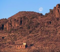 Fort Davis National Historic site  old building with Moon setting at daybreak