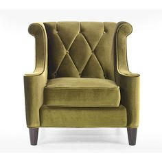 Generate a comfortable atmosphere in your home with this modern take on a retro chair. This green velvet fabric chair features a button-tufted back with a diamond pattern and espresso wood legs.