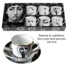 Fornasetti.  Cutest tea set ever!  But the price - Gah!  $1842 with gold rim.  Knock off 307 without.