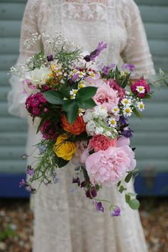 Lush, loose bouquet with peonies, daisies, roses, baby's breath, and more!