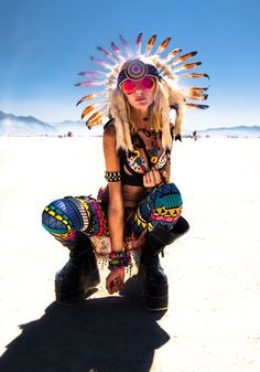 a reminder, because I see many pins like this -- DON'T wear feathered headdresses on the playa. two reasons: 1) feathers aren't allowed in BRC. period. they shed & harm the desert environment. 2) appropriation of other cultures, especially spiritual items like native american headdresses, is VERY UNCOOL: http://nativeappropriations.com/2010/04/but-why-cant-i-wear-a-hipster-headdress.html there are so many creative & unique costumes you can wear to burning man! but PLEASE, no headdresses.