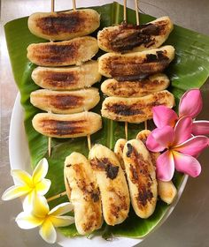 Grilled Sweet Banana on a stick  Thai style it's so good for the summer