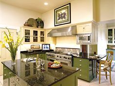 green cabinets and dark counters