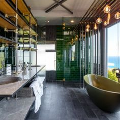 A green bathtub, an ocean view and gold lights ─ this bathroom would inspire you to re-decorate your own! Gold Light, Bathroom Inspo, Beautiful Bathrooms, Modern Decor, Bathtub, Ocean, Inspire, Lights, Travel