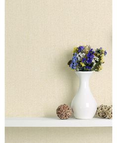 This Crown Jasmine Glitter Textured Wallpaper in ivory has a textured finish and is infused with shimmering glitter particles. Free UK delivery available
