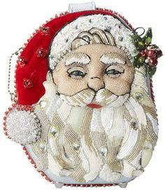 Mary Frances Ho Ho Ho Beaded Jeweled Santa Christmas Holiday Handbag Shoulder Bag. Experience the true Mary Frances wonder with this Ho Ho Ho Santa. This fabulously extensively beaded & jeweled embellished Santa Handbag is the quintessential accessory for the season!. Glamorous gold and playful silver hues offset the dark backdrop of Santa and his sleigh in this fun and feminine novelty bag. Dress it up or down, this handbag is perfect for any occasion and will surely have your friends...