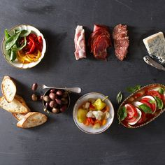 Antipasto Tray - cured meats, Bold cheese, Caprese, Pickled veggies, Olives, Roasted peppers, Bread slices