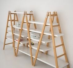 three wooden ladders into bookcase