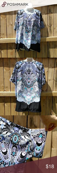 """*Dana Buchman* Sz M Purple Black Paisley Tunic Beautiful, flowy Dana Buchman top.   Size Medium. M  Excellent, gently used condition. Please check out all of the pictures to determine the condition and measurements.  Purples, Black, White, and a bit of Blue in a Paisley design. 4 hidden buttons down the front to either wear open or closed. Back hem is around 2"""" longer than the front. Very comfortable.  Thanks so much for looking and please feel free to ask any questions :-).  From a…"""
