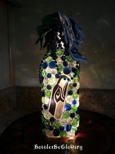 Looking for that special something for the Seahawk fan in your life? Well this Seattle Seahawk bottle light should fit in perfectly! The blue, Lighted Wine Bottles, Wine Bottle Art, Bottle Lights, Wine Bottle Crafts, Water Bottle, Seahawks Game, Seahawks Super Bowl, Seattle Seahawks, Football Crafts