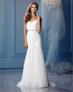 A strapless, fuss-free wedding gown  What keeps a sweetheart neckline from looking too cutesy? A slim skirt and a sleek belt—just the thing for a cosmopolitan wedding! Wtoo Cyprus Gown