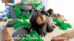 Toothless baby shower cake