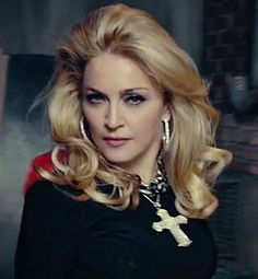"Madonna's best look EVER and it's now. From 3:12 in her current video, ""Give Me All Your Luvin' (Feat. M.I.A. and Nicki Minaj)"""
