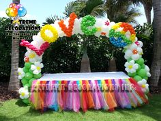 Extreme Decorations did this beautiful and colorful Peace Love 60's Party decoration. This cake table had a tutu skirt with rainbow colors, and the balloon arch had the LOVE and PEACE sign. Great party idea for a Hippie party! Extreme Decorations Miami. Ph: 786-663-8198 email us to extremedecorations@gmail.com