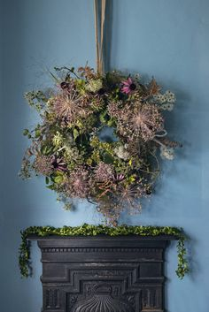 To ring the changes, why not replace some of your Christmas accessories with festive flowers? This exquisite wreath is made from seed heads, dried leaves and foliage. http://www.hglivingbeautifully.com/2015/12/09/festive-decorating-ideas-for-your-mantelpiece/