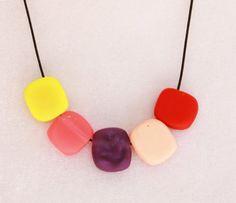 Warm neon and pastel tile bead adjustable resin by serenakuhl, $25.00
