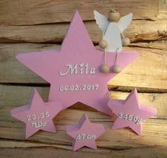 Stars with name and date of birth and small guardian angel made of wood as a great decorative element, e. on the nursery or as a gift for birth or baptism.