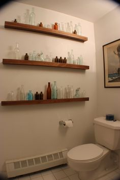 Jove's Bright Home with Inventive Features-- great way to display old bottle -- maybe not in a bathroom