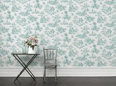 A large-scale, ink-painted Toile de Jouy-patterned wallpaper printed on a linen-texture background. The decorative French pastoral design comes from Boråstapeter's archive and has been adapted to give the perfect patina feel.