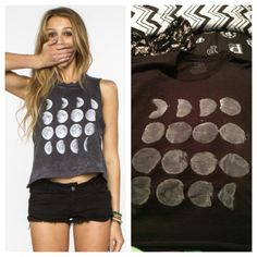 DIY moon phase tank  Just buy a win black t shirt from a craft store Then cut off the sleeves  and the bottom to make it a crop top Trace 4 circles on a pics of paper and make them into stencils Trace four rows then copy the phases with white fabric paint and a sponge brush