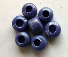 Crow Beads Blue with a Silvery Coating Opaque size 9mm x 6mm with a 3mm hole