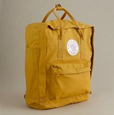 yellow backpack: By Fjallraven, available at jcrew by ursula