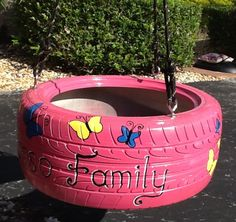 Tire Swing with Butterflies personalized with the family name from www.cooltireswings.com.