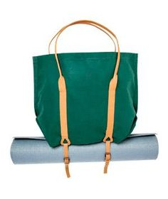 Mimot Studio Folding Canvas Tote With Carrier Straps: Free up an arm with a leather-handled canvas tote that gives your yoga mat a place to hang out. Off duty, this sack collapses, tucks, and ties to store.