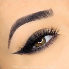 Using the full spectrum eyeliner pencil in 'obsidian', following the shape of the lid, create a dramatic wing, stopping a third of the way look by Paulina Alaiev.