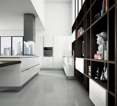 Bella is characterized by wood textures and simple, essential lines, giving the collection a unique flair while remaining true to Aran Cucine's artisan craftsmanship. These cabinets look especially attractive with integrated c-channel or flat channel handles because of Bella's unique thickness. Bella also offers open shelving for the kitchen or living room.