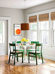 Paint your chairs a fun color for a refreshed look! More ideas here: http://www.bhg.com/decorating/small-spaces/homes/open-space-cottage-makeover/?socsrc=bhgpin071014casualdining&page=6