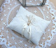 Bearer Wedding Ring Cushion, Ring Pillow in Beige Raw Silk With Antique Ivory Lace. $39.00, via Etsy.