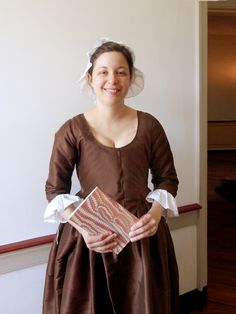 "Replica gown - 1775 ""Phebe Massey"" dress - re-created from an extant dress in Broomall, PA.  Round gown style with apron drop front, made in chestnut-brown silk like the original."