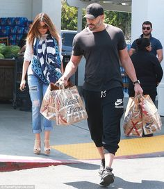 Macho man: Hunky 38-year-old Joe carried the couple's multiple paper bags from the market...