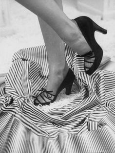 Model Showing Off Satin Pumps for the Spring Season, at Saks Fifth Avenue
