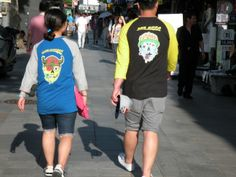 2013/09/02 - Trigenerian couple with nice graphic T-shirts.