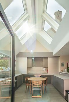 Love this kitchen extension, such a clever use of light, Love how the daylight streams through the multiple skylights, velux roof windows absolutely make the most of this space. Such a great way to change a family home. Kitchen Extension Velux, Kitchen Orangery, Home Pizza Oven, Open Plan Kitchen Living Room, Interior Decorating, Interior Design, Decorating Ideas, Cottage Decorating, Modern Roofing