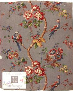 1924  This roller-printed cretonne was designed by Winifred Mold for the Silver Studio and manufactured by Marshall Roberts Ltd in 1924. 'Cretonne' is a strong, printed cotton fabric, suitable for furnishings This textile features sprays of flowers and plant motifs with exotic Chinese-inspired birds. 'Chinoiserie' designs such as this were popular among British consumers during the 1920s.  ST407