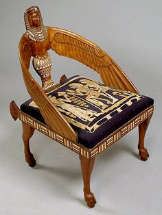 Carved Egyptian Revival armchair. Made in Egypt, circa 1925-30. Pieces like this became very popular in the Art Deco period.