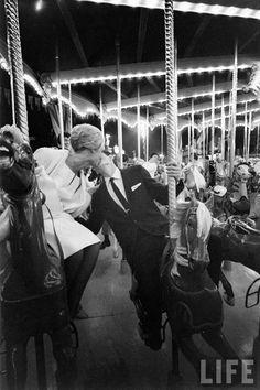 carousel love at disneyland, 1961      All-night prom at Disneyland, 1961.By Ralph Crane.    kiss me around the carousel.